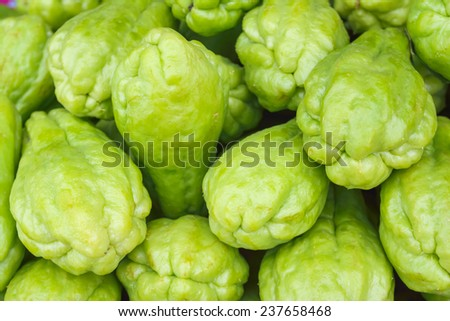 Pile chayote fresh vegetables on the market - stock photo