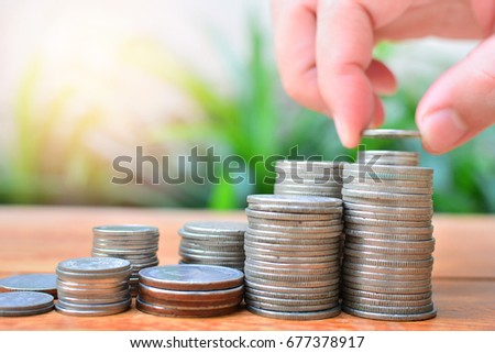pile coins saving to investment fund for concept business and financial