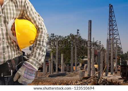 Pile driver  works to set precast concrete piles in a construction area - stock photo