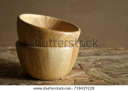 Pile empty wood bowl on rustic wooden background.
