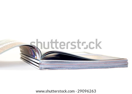 Pile from few magazines on white background