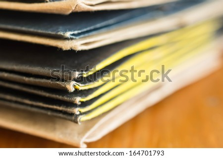 Pile from paper packages on a wooden surface