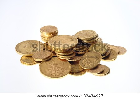 Pile Gold coins american and french on white background