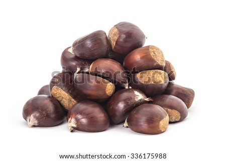 Pile, heap, of fresh organic chestnuts isolated on white background - stock photo