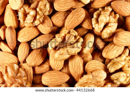 pile of almond nuts and walnuts as background