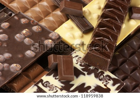 Pile of assorted chocolate bars close-up. - stock photo
