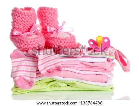 Pile of baby clothes isolated on white - stock photo