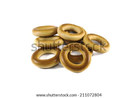 pile of baked crispy cracknels isolated against white