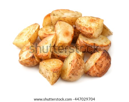 Pile of baked potatoes wedges isolated on white