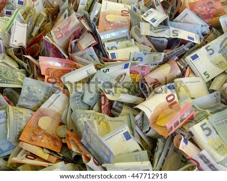 pile of banknotes from different countries (euros and dollars) - stock photo