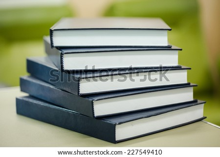 Pile of big blue books - stock photo