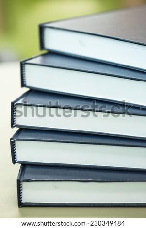 Pile of big text book - stock photo