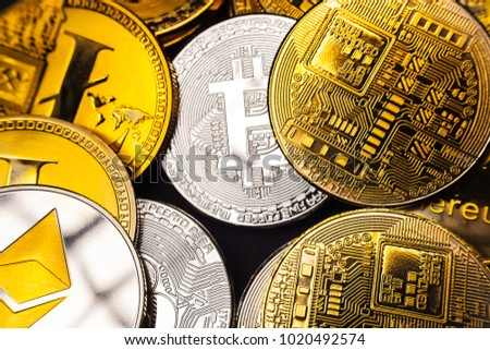 Pile of Bitcoins and various Cryptocurrencies