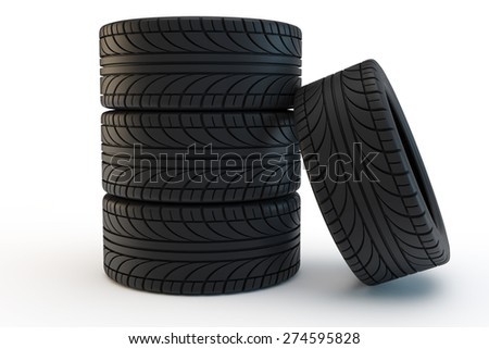 pile of black car tires, one tire leans on a pile