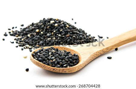 pile of black sesame on wooden spoon - stock photo