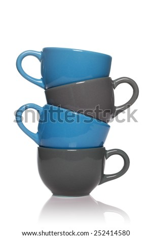 Pile of blue and grey tea cups isolated on white background. - stock photo