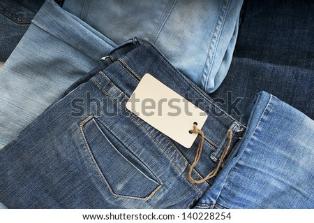 Pile of blue jeans with tag label. - stock photo