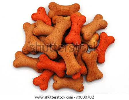 Pile of bone biscuits for dog isolated over white background - stock photo
