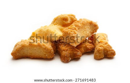 Pile of bone formed cookies on white background