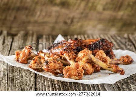 Pile of bones from already eaten barbecued chicken wings. - stock photo
