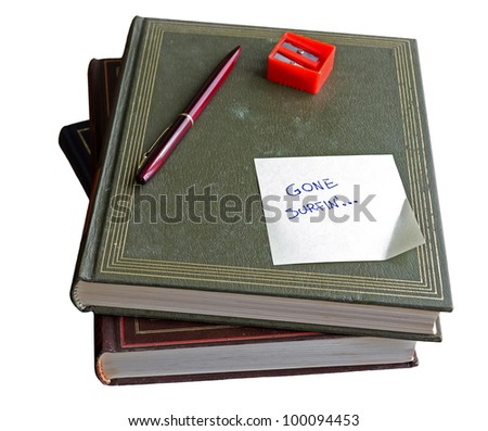 "pile of book with ""gone surfing"" note on a white background"