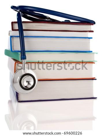 pile of books and stethoscope isolated on white background - stock photo