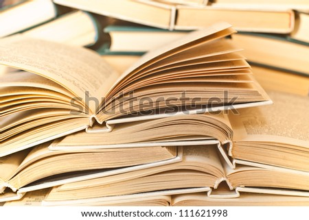 Pile of books in the yellowish colors - stock photo