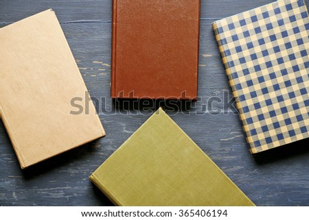 Pile of books on wooden background - stock photo