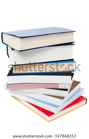 Pile of books over white background