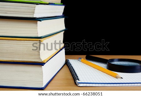 pile of books, pencil on notebook  on table - stock photo