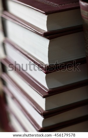 pile of books stacked volume, hardcover - stock photo