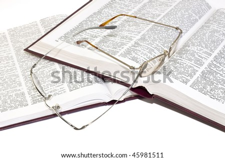 pile of books with glasses isolated on white