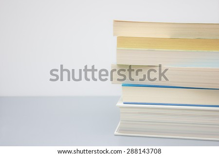 Pile of books with space for text