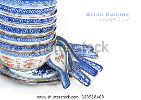 Pile of Bowls and spoons of Asian cuisine, with copy space for menu text - stock photo