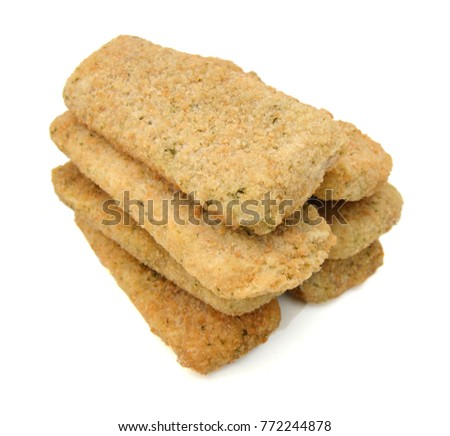 Pile of breaded crab sticks isolated