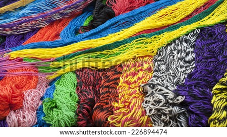 Pile of brightly colored hammocks for sale in Mexican market