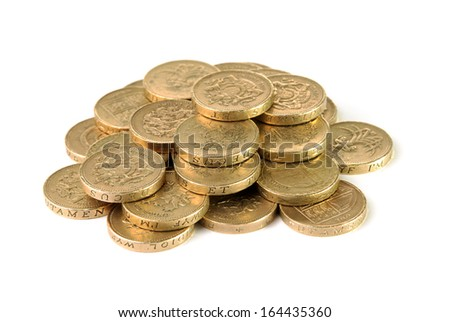 Pile of British pound coins on a white background - stock photo