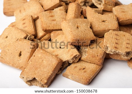 Pile of broken dog treats - stock photo
