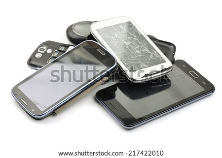 Pile of broken smart phones - stock photo