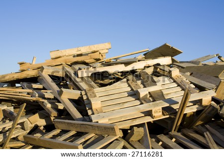 Pile of broken wooden skids at construction site - stock photo