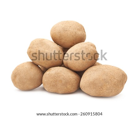 Pile of brown dirty earth covered potatoes isolated over the white background - stock photo
