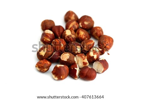 Pile of brown hazelnuts on white background. - stock photo