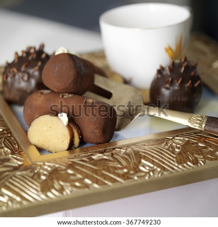 Pile of brownie cakes laid on a golden plate, closeup with shallow depth of field - stock photo