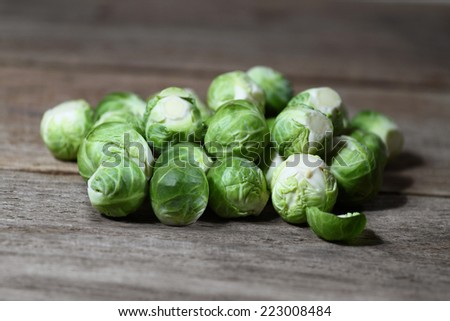 Pile of brussels sprouts on wooden table closeup - stock photo
