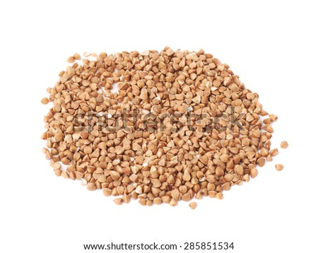 Pile of buckwheat seeds isolated over the white background - stock photo