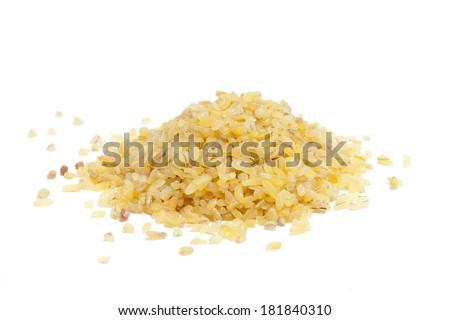 pile of bulgur on white  - stock photo