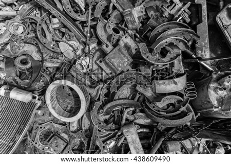 Pile of car parts with black and white - stock photo