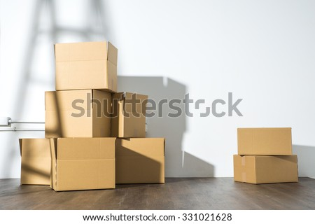 Pile of cardboard boxes on white background with  Ladder shadow, nobody - stock photo