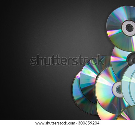 Pile of CDs on black background