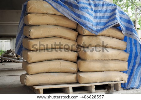 Pile of cement bags in the construction site, Cement bags in construction of a projects.
